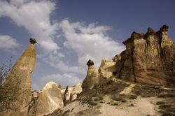 Image: Fairy Chimneys near the village Cavusin in Cappadocia | Photo by Evelyn Kopp ASMALI CAVE HOUSE Small Cave Hotel in Cappadocia, Turkey